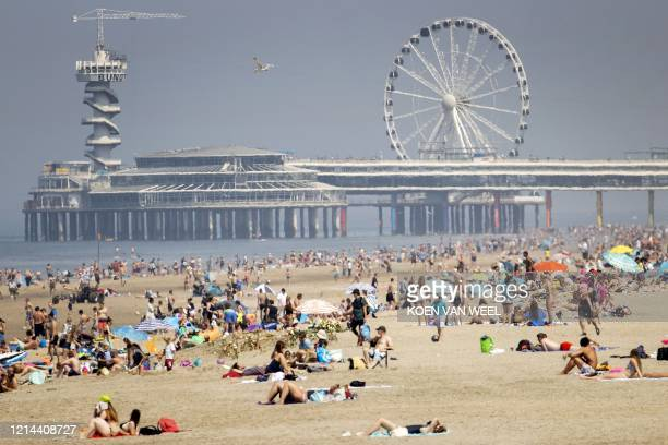 People enjoy the beach of Scheveningen on Ascension Day, near The Hague, The Netherlands, on May 21, 2020 during the ongoing COVID-19 infection,...