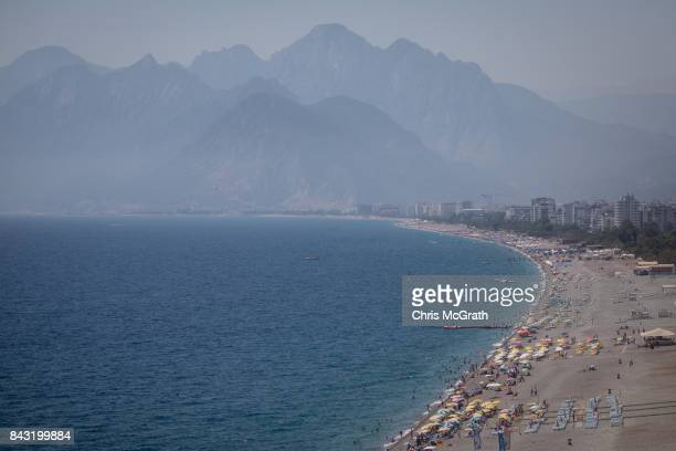 People enjoy the beach on September 4 2017 in Antalya Turkey Turkey's tourism industry spiraled into crisis in 2016 after a year of terrorist attacks...