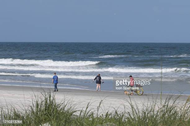 People enjoy the beaches in its first open hour on April 17 2020 in Jacksonville Beach Fl Jacksonville Mayor Lenny Curry opened the beaches to...