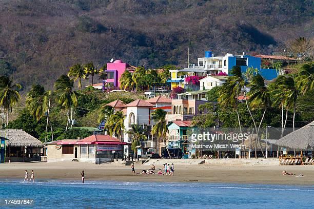 People enjoy the beachfront of San Juan