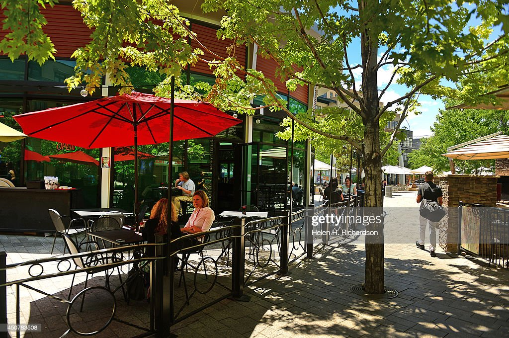 People Enjoy The Beautiful Weather And Outdoor Ping Restaurants At Belmar Center In