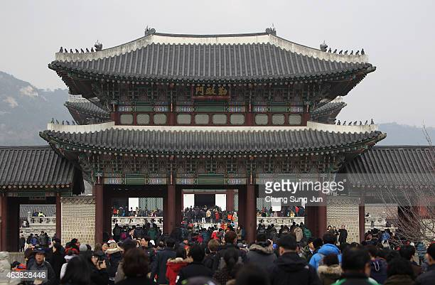 People enjoy the celebrations during a Lunar New Year day at Gyeongbokgung royal palace on February 19 2015 in Seoul South KoreaThe Lunar New Year is...