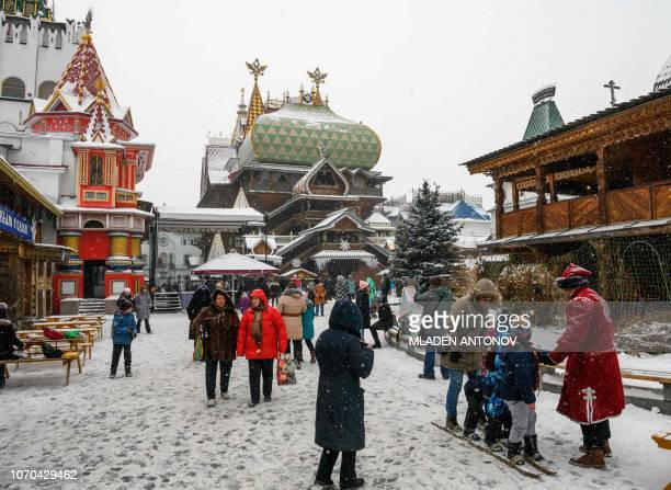 People enjoy the Christmas decoration at the ethnographic and amusement center 'Kremlin in Izmailovo' in Moscow on December 9 2018