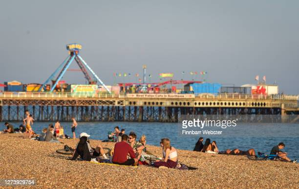 People enjoy the evening sunshine on Southsea beach on September 21, 2020 in Portsmouth, England.