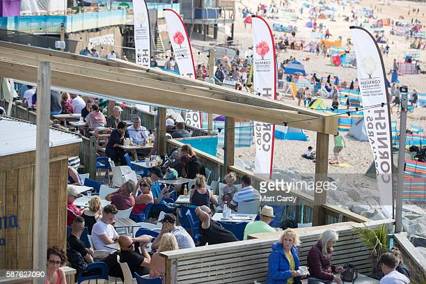 People enjoy the fine afternoon weather at Fistral Beach in Newquay on August 9 2016 in Cornwall England From tomorrow the Cornish seaside town will...