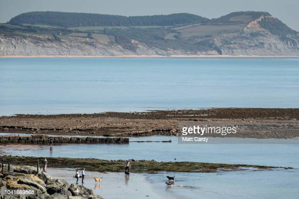 People enjoy the fine autumnal weather in Lyme Regis on September 27, 2018 in Dorset, England. After the hottest summer on record, weather...
