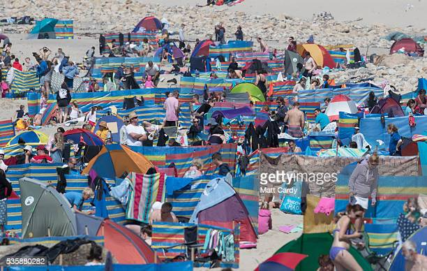 People enjoy the fine weather as they gather on the beach at Sennen Cove on May 30 2016 in Cornwall England As some parts of the UK were bathed in...