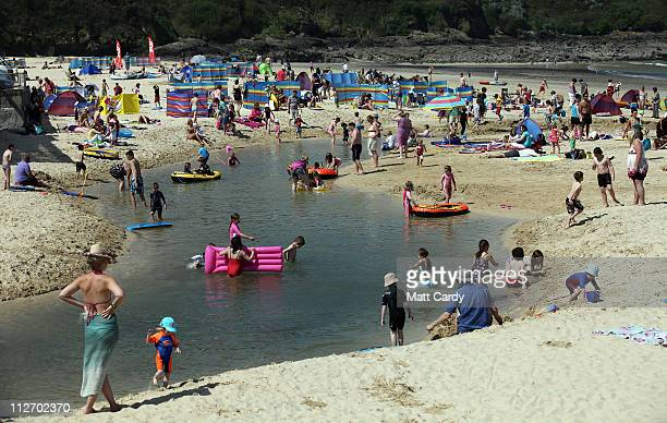 People enjoy the fine weather at Carbis Bay on April 20 2011 in St Ives Cornwall England The UK is currently basking in fine weather with the Met...