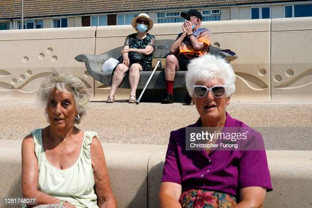 People enjoy the fine weather at Thornton Cleveleys promenade on June 24, 2020 in Blackpool, United Kingdom. The UK is experiencing a summer...