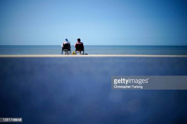 KINGDOM JUNE People enjoy the fine weather at Thornton Cleveleys promenade on June 24 2020 in Blackpool United Kingdom The UK is experiencing a...