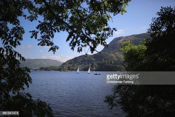 People enjoy the fine weather at Ullswater on August 17 2016 in Glenridding England The Lake District continues to recover after the devastating...