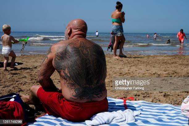People enjoy the fine weather on the beach on June 24 2020 in Blackpool United Kingdom The UK is experiencing a summer heatwave with temperatures in...
