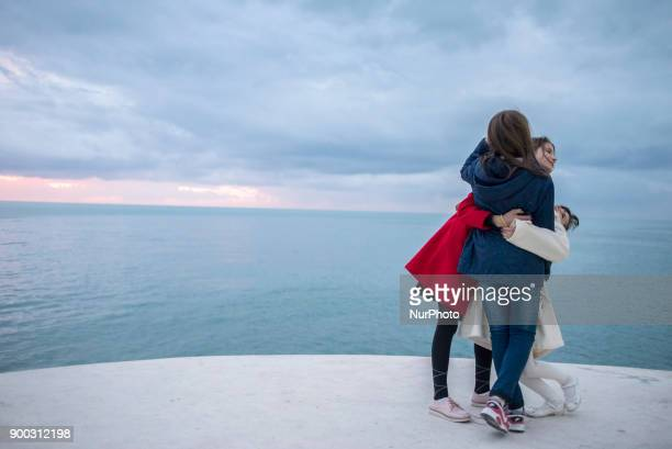 People enjoy the first day of the New Year on the promenade of Durres Albania on January 1 2018