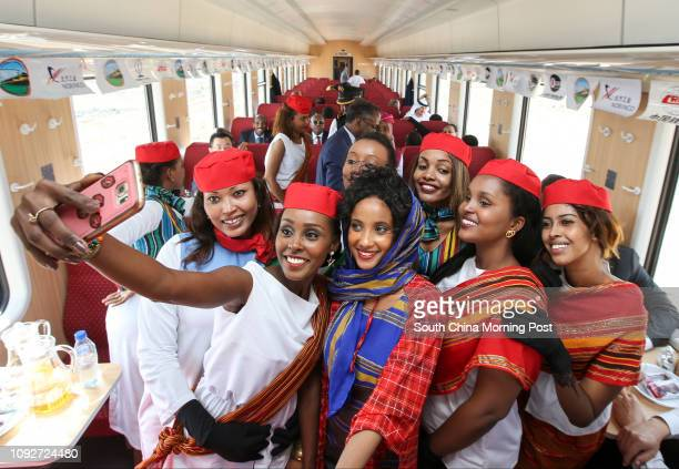 People enjoy the first departure of the Djibouti Addis Ababa Railway at Gare De Nagad Station The railway is supported by China Civil Engineering...