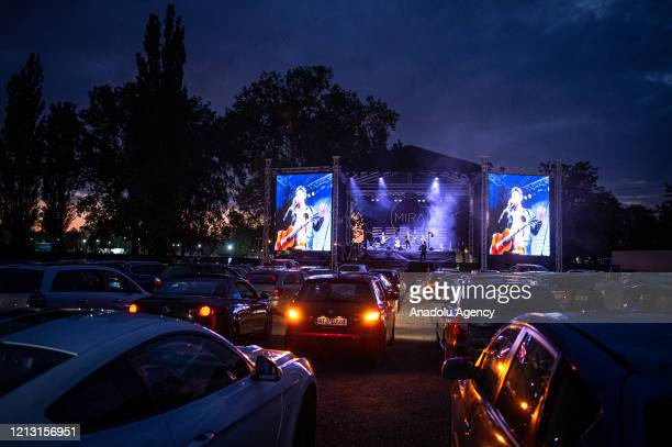 People enjoy the first largest live car concert featuring the band Mirai in Ostrava, Czech Republic on May 15, 2020. The band played their car...