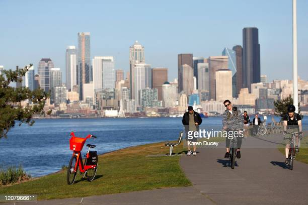 People enjoy the fresh air and sunshine while bicycling at Alki Beach Park on March 20 2020 in Seattle Washington Washington Gov Jay Inslee has...