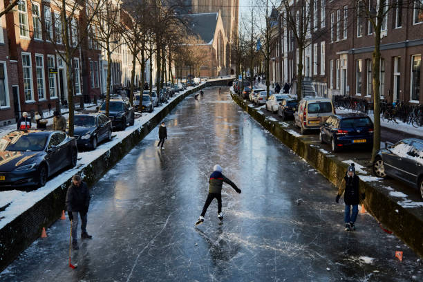 NLD: Dutch Ice Skaters Take To The Canals Of Delft As Subzero Temperatures Persist