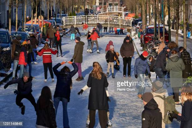 People enjoy the frozen canals on February 13, 2021 in Delft, Netherlands. Parts of central and northern Europe and Britain have experienced...