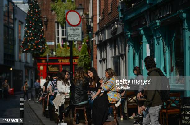 People enjoy the good weather and outdoor drinks in Dublin's Temple Bar. On Thursday, 01 July 2021, in Dublin, Ireland.