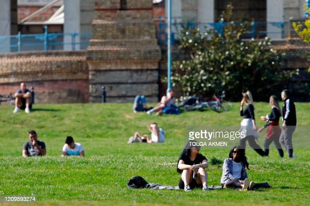 People enjoy the holiday sunshine in Alexandra Park in north London on April 10, 2020 as warm weather tests the nationwide lockdown and the long...