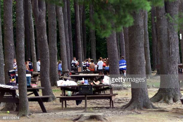 People enjoy the Hopkinton Reservoir and beaches here in the park This is the picnic area near the bathing pond