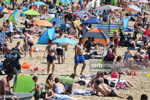 People enjoy the hot weather at Bournemouth beach during the UK's spring bank holiday on May 25, 2020 in Bournemouth, United Kingdom. The British...