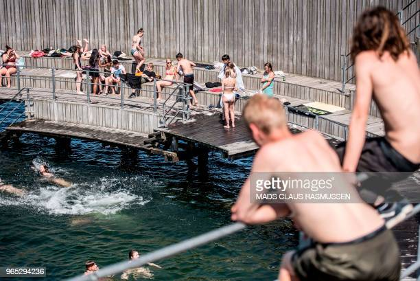 People enjoy the hot weather at Kastrup seaside resort in Copenhagen on June 1 2018 Temperatures rose to 30 degrees Celsius in the Danish capital /...