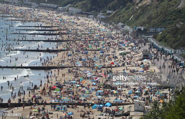 People enjoy the hot weather on Durley and Alum Chine beaches in Dorset following the introduction of measures to bring the country out of lockdown