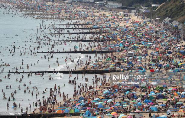 People enjoy the hot weather on Durley and Alum Chine beaches in Dorset