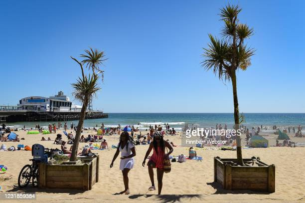 People enjoy the hot weather on the beach on May 29 2020 in Bournemouth United Kingdom The British government continues to ease the coronavirus...