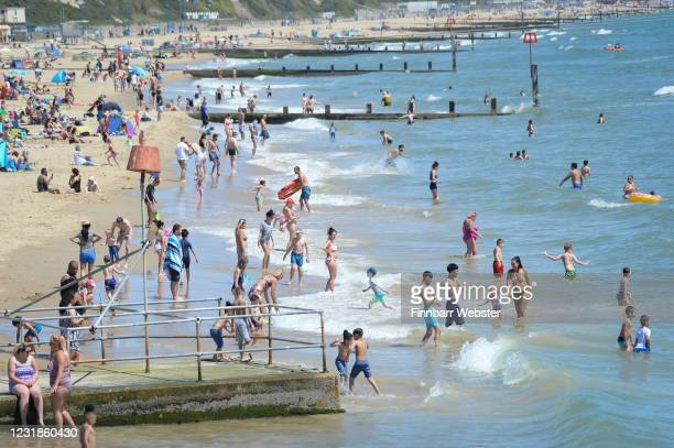 People enjoy the hot weather on the beach on May 29, 2020 in Bournemouth, United Kingdom. The British government continues to ease the coronavirus...