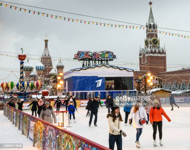 People enjoy the ice at a skating rink on Red Square in Moscow on December 6 2018