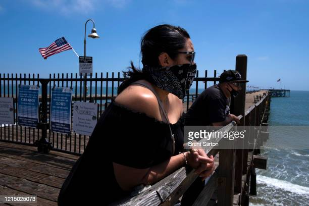 People enjoy the less restricted beachfront over Memorial Day weekend May 24, 2020 in Ventura, California. Officials said people for the most part...