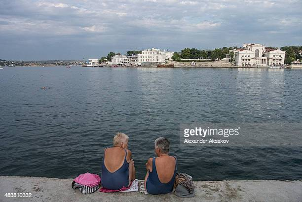 people enjoy the main city beach in Sevastopol on August 12 2015 in Sevastopol Crimea Russian President Vladimir Putin signed a bill in March 2014 to...