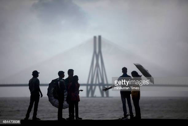 People enjoy the monsoon at Dadar on September 1 2014 in Mumbai India With heavy rains lashing the city for second consecutive day the MeT department...