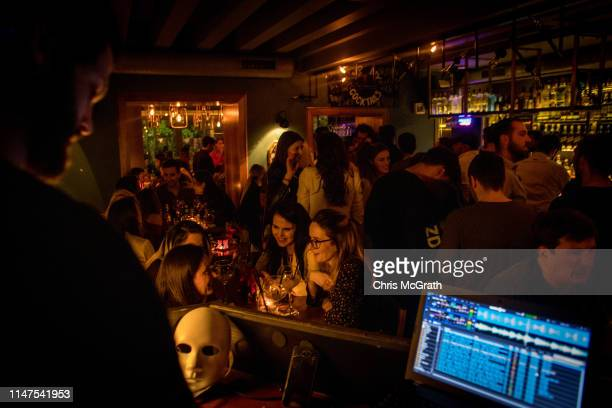 People enjoy the night at the upscale bar and nightclub Bon Vivant on May 3, 2019 in Pristina, Kosovo. A recent EU-backed summit failed to restart...
