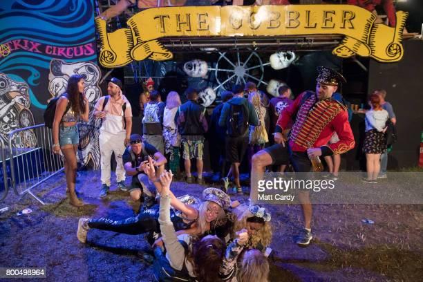 People enjoy the night time areas at the Glastonbury Festival site at Worthy Farm in Pilton on June 23 2017 near Glastonbury England Glastonbury...