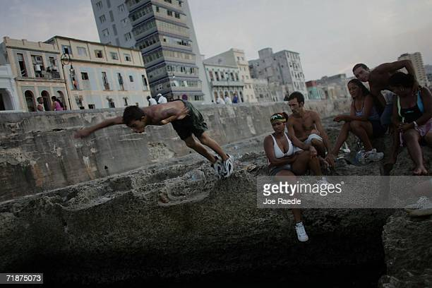 People enjoy the ocean water next to the Malecon September 12 2006 in Havana Cuba Cuba hosts the 14th NonAligned Nations Summit which currently has...