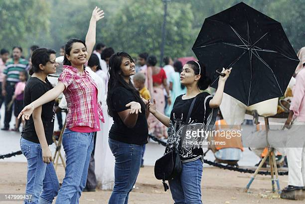 People enjoy the pleasant afternoon weather after yesterday's rain on July 7 2012 in New Delhi India The arrival of monsoon in the region brought the...