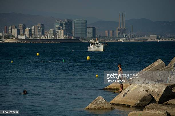 People enjoy the sea at Barceloneta Beach on July 24 2013 in Barcelona Spain Foreign visitors to Spain set a new record high in June surpassing six...