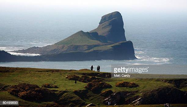 People enjoy the sea view at Worm's Head near Rhossili on the Gower Peninsula on April 3 2008 in Wales United Kingdom A draft Marine Bill published...