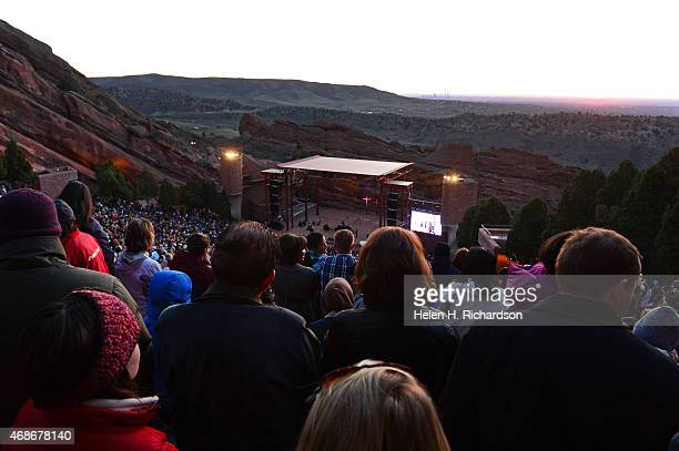 People enjoy the service as the sun begins to rise during the 68th annual Easter sunrise service at Red Rocks Amphitheatre in Morrison Colorado on...