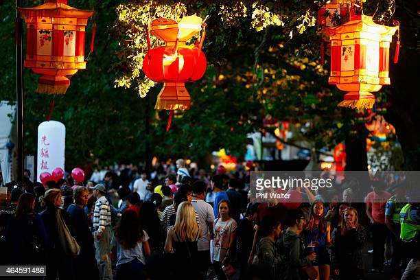People enjoy the sights sounds and smells as they wander through the Lantern Festival in Albert Park on February 27 2015 in Auckland New Zealand New...