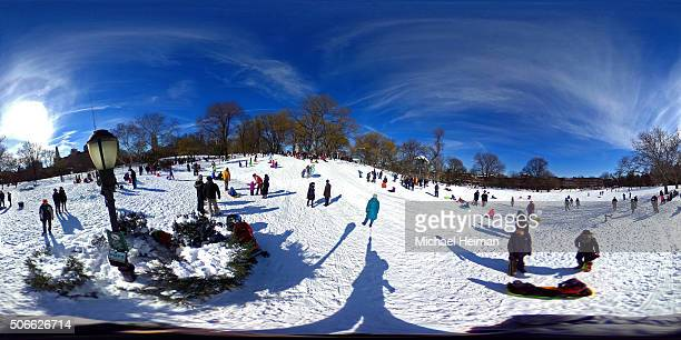 People enjoy the snow in Fort Green Park on January 24 2016 in the Brooklyn borough of New York City Most of New York's streets were cleaned up...