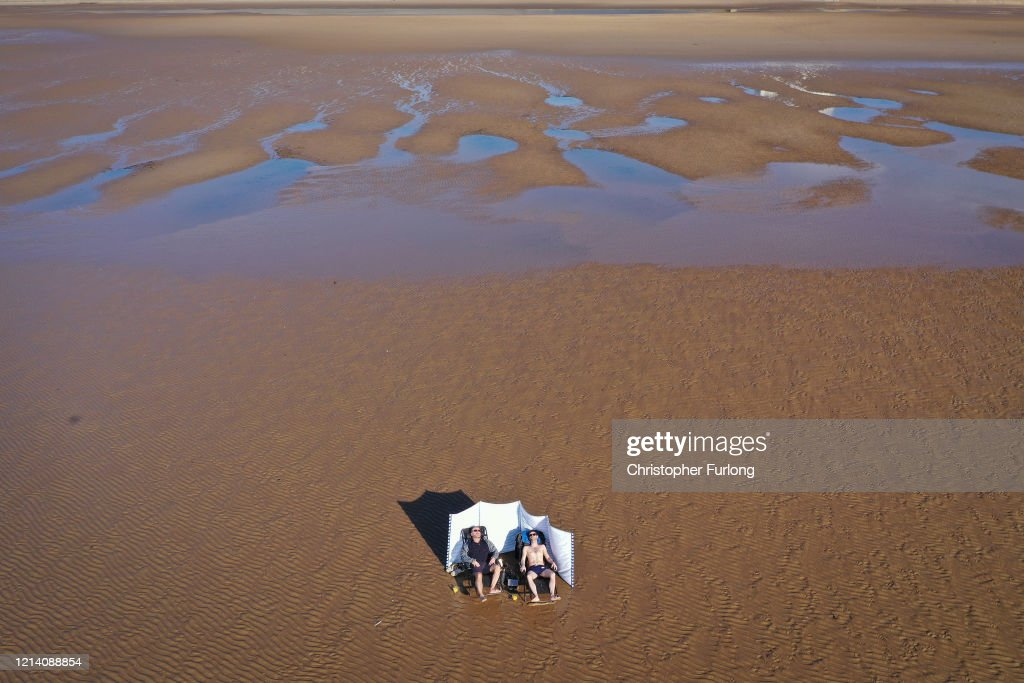 Coastal North Western England Sees The Effects Of Warnings To Self Isolate : News Photo