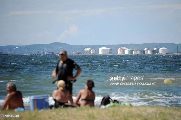 People enjoy the summer sunshine along the GR2013 hiking trail, beside the Bolmon pond, on July 29 in Marignane. The GR2013, a hiking trail which...