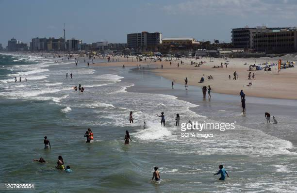 People enjoy the sun and surf during a spring break at Daytona Beach after Florida Governor Ron DeSantis refused to order the state's beaches closed...