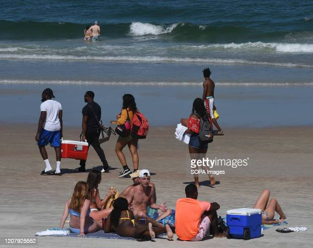 People enjoy the sun during a spring break at Daytona Beach after Florida Governor Ron DeSantis refused to order the state's beaches closed as the...