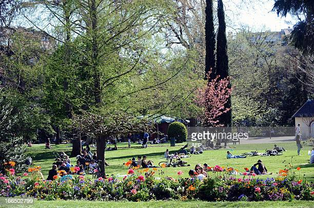 People enjoy the sun in a public garden on April 13 2013 in Toulouse southern France AFP PHOTO / REMY GABALDA
