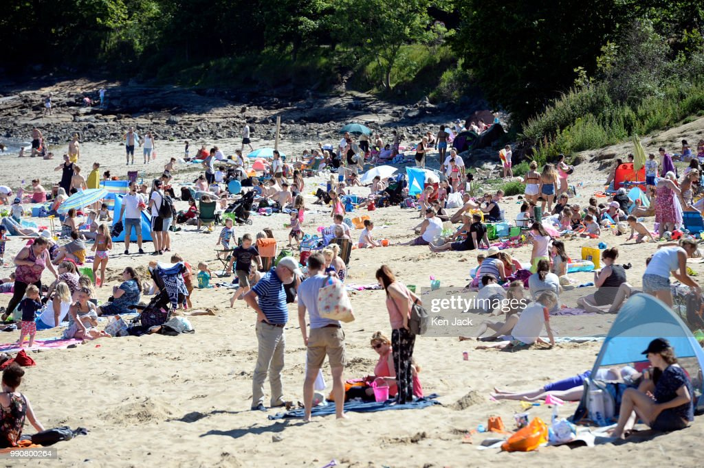 People enjoy the sun on Silver Sands beach at the start of the Scottish school holidays as the heatwave continues, on July 3, 2018 in Aberdour, Scotland.